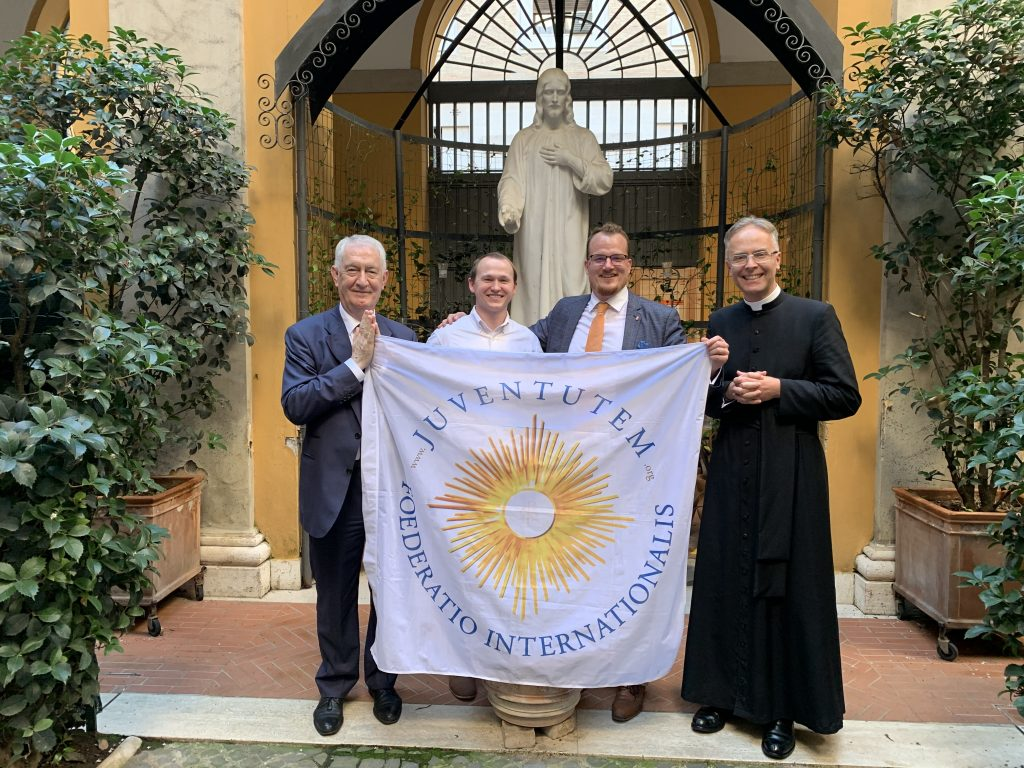 The Bureau of the FIJ: Treasurer Cosimo Damiano Marti, Secretary Nicholas Heiny, President Bertalan Kiss, and  International Ecclesiastical Assistant Fr. Armand de Malleray FSSP.